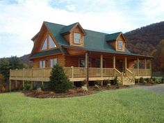 Highlands V Log Home features open loft, spacious living room and three bedrooms. Total square footage 1693 sq. ft.