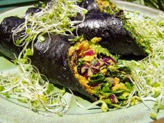 """Raw """"Curry Wasabi Nori Rolls"""" (with red cabbage, carrots, cilantro, tomato, pine nuts ... and more) wrapped in nori. Tasty and filling. Click to the site for exact recipe."""