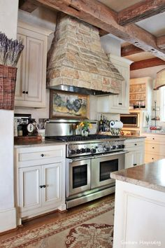 Beautiful home tour of a stone house in Vinings, GA which sits on a lake.  Gorgeous reclaimed brick and wood, European feel.