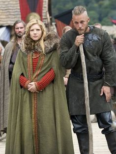 Here Lagertha wears a bilberry-dyed lime green cape and an orange woolen maternity dress. Her husband Ragnar (Travis Fimmel) wears black leather pants and an elaborated molded, decorated black leather vest emblazoned with his insignia -- the raven -- that symbolizes his descent from the great Norse god Odin, also a god of slain warriors and curiosity.