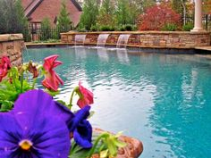 This pool begins with a beach entrance near the house and includes three waterfalls. Sizable plantings of Leyland cypress, deodar cedar and hollies help provide enclosure and privacy for the outside. The best part of this pool however, is the outdoor kitchen (see the next slide).