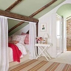Bright idea: If you have an attic space with a pitched ceiling, create a cozy hideaway with a twin bed enclosed by curtains.  Good place to tuck up with a book.