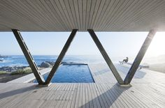 Built by LAND Arquitectos in Zapallar, Chile with date 2012. Images by Sergio Pirrone. Rambla House, is a weekend house located along the central coast of Chile, at Zapallar City, about 175 km from Santia...