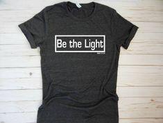 Christian T Shirt- Christian shirt be the light christian shirt for women, for men, faith based clothing, christian bible verse shirt #etsy #womensclothing #christiantshits http://etsy.me/2EhXWR7