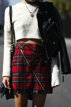 Plaid skirt, crop top and leather jacket