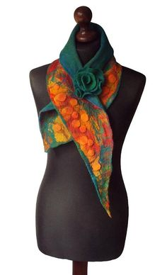 Nuno felted collar/ scarf made from finest Australian merino wool and hand dyed silk fabric. Handmade nuno felt technique. Collar with felted flower brooch - metal pin closure.  Size: length: 113cm (44,49) width: 11 - 22cm (4,33 - 8,66) Colors: multicolor - shades of red, yellow, orange, pertol green, petrol blue, emerald green.  Visit my fan page on Facebook: www.facebook.com/pracownia.artystyczna.arteduo  More scarves you can find here: www.etsy.com/shop/MarlenaRakoczy?s...