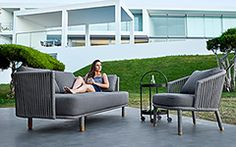 Bentley Sofa Collection | Welded, powder coated iron frame | Side panels formed with Sunbrella rope | Sunbrella natte grey cushions | Designed in Denmark