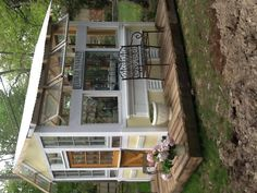 My husband built this from old windows and doors I love it! - My husband built this from old windows and doors I love it! Diy Greenhouse Plans, Backyard Greenhouse, Small Greenhouse, Greenhouse Wedding, Old Window Greenhouse, Portable Greenhouse, Greenhouse Growing, Pallet Greenhouse, Homemade Greenhouse