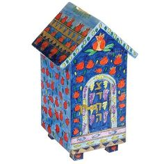 This beautiful tzedakah box in the shape of a house is the perfect way to beautify the mitzvah of giving charity and to show that in Judaism, giving is the