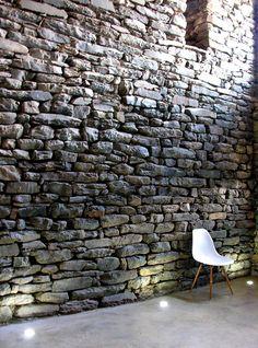 Stone wall in sunlight. Mas La Riba by Ferran Lopez Roca Arquitectura.
