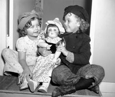 """1936 Ginette Marboeuf-Hoyet """"the French Shirley Temple"""" presents the real Shirley with a doll."""