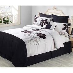 Maybe this bedding set (Fulton 8-Piece Comforter Set, Black and White)