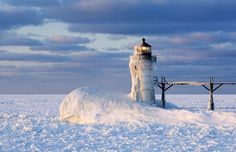 Ice-coated lighthouse, St. Joseph, Mich. (© RGB Ventures/SuperStock/Alamy)