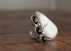 White Buffalo Turquoise Ring with 3 Black Accent Stones