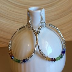 Swarovski crystal hoop earrings These are made with 10 different colors of Swarovski crystals. They are gorgeous. The ear wires are 925 Sterling silver. The beads and tubes are silver plated. They hang just over 2 inches. Handmade by me NWOT Jewelry Earrings