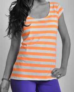- Remera naranja y blanca: ART: 118006-12    - Legging violetas. ART:  154703-09