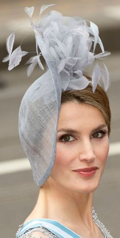 Crown Princess Letizia of Spain wears a face-framing and very flattering variation of the saucer hat. Hat by Maria Nieto hat.