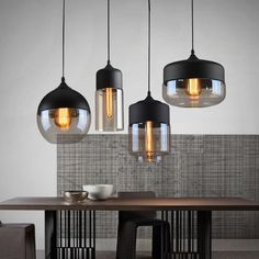 Minimalist, streamlined silhouette design A welcome addition to any modern space, our Glass Pendant Light is a multi-tone lamp that features both classic and trend-forward design. High quality perfect for any space Crafted from premium iron and glass, our Glass Pendant Light is the perfect feature piece to hang over kitchen islands, in bathrooms, and any other place where you're really looking for a pop of light and modern design. Double, triple, or quadruple up Create an eye-catching… Luminaire Vintage, Deco Luminaire, Luminaire Design, Luminaire Mural, Modern Pendant Light, Glass Pendant Light, Glass Pendants, Glass Chandelier, Pendant Lamps