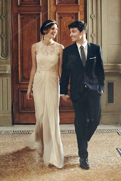 Great Photo: Any bridal couple would kill for a photo of this quality.  Pretty gown constructed of crinkled silk chiffon and lace, this softly contoured gown from Tadashi Shoji gathers at the center to create an hourglass shape, then flows softly at the back into an elegant train. Tiny lightweight beads are placed overtop the lace and catch the light in the prettiest way. Flora Gown from BHLDN. Flora Gown STYLE: 33060005