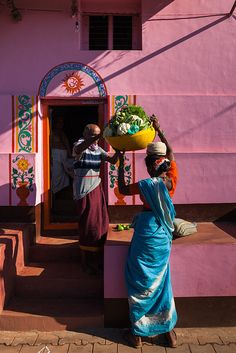 Woman selling vegetables in a colorful street of Gokarna, Karnataka, India. by marji lang via flickr