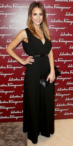 flowing black gown and baguette-shaped clutch (all by Ferragamo)