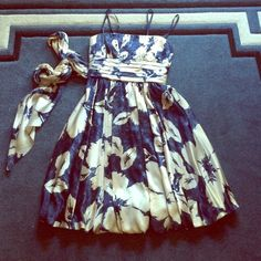 BCBG strapless cocktail dress Navy with white flower/leaf pattern. In excellent condition. Worn once for an event. Satin tie for waist. BCBGMaxAzria Dresses Prom