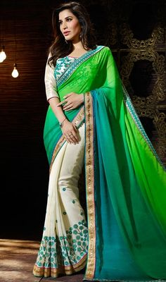 Move eyes on stalks dressed like Evelyn Sharma in this Sophie Chaudhary green, blue and cream color georgette raw silk sari. The charming lace, resham and stones work a considerable element of this attire. #eveninglooksari #reshamworksaris #lovelysareedesign