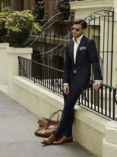slim-fitting dark suit with brown shoes; slim-fitting shirt, no tie. Love this!