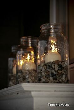 i like the neutral pebbles in the jar.. id get different jars and they would hold my make up brushes