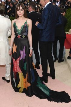Dakota Johnson accessorised her Gucci gown with Norman Silverman diamond bracelets.