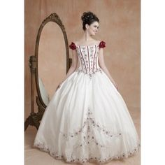 White ball gown quinceanera dress features off-the-shoulder design with  roses accented 3fa2e0e09f75