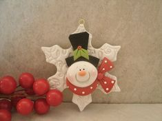 Snowman and Snowflake Christmas Ornament by countrycupboardclay on Etsy.  Image only.