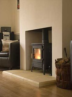 Love this Hearth/ log burner combo. Simple & understated