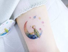 The Little Prince inspired tattoo on the left inner arm.