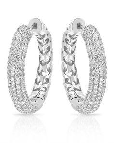 Fabulous hoop earrings with genuine diamonds in white gold.
