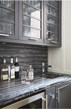 bar and pantry featuring charcoal cabinetry and dramatic countertop designed by douglas design studio