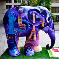 """Around The World"" by Nilesh Mistry, part of the Elephant Parade in London.    Painting a brighter future for the endangered Asian elephant  Elephant Parade is a conservation campaign that shines a multi-coloured spotlight on the urgent crisis faced by  . Amazing places around the world!"