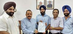 "Union Minister Dr Jitendra Singh receiving a memorandum from Delhi Taxi Tourist Transports & Tour Operators Association"" at New Delhi."