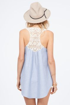 Chambray Denim is the essential beach vacay staple!  This Gorgeous Tank features a high low hemline with crochet back detail.  Easy body style to wear with Fabulous fit and flare shape.  Chambray is the lightest weight denim out there.  You will feel like your wearing a cloud!