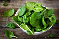 White Bowl With Fresh Spinach Leaves