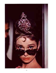 Only she could get a way with wearing a tiara and sunglasses...