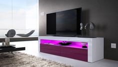 This modern 50 inch tv stand perfectly achieves effortless simplicity, while still accomplishing a striking yet elegant look black tv unit. The tv table stand high gloss is contrasted by Blue LED lights in the center of the stand. This modern tv unit also has two space. Tall tv stand