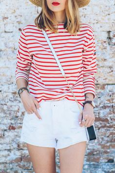red striped shirt, red lipstick, white jean shorts