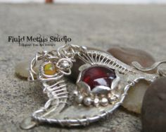 Check out Scarlet Fire sterling silver, garnet and opal DA0022 on fluidmetalsstudio