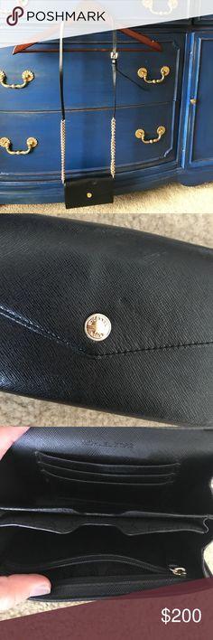 Small Black Michael Kors purse. Small black leather Michael Kors purse. Detachable strap to wear as a wallet. Michael Kors Bags Crossbody Bags