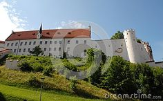 Photo made in the town of Fussen in Bavaria (Germany). In the picture you see the big castle, the white walls as the walls and its tower, restored the city which is located on top of a green hill.