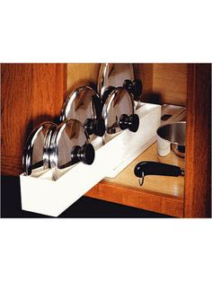Lid Maid Lid Organizer $6 Put a lid on cabinet clutter with this easy-to-install lid organizer. The tray features two slots for pot and pan lid...
