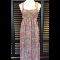 Beautiful Maxi Dress Size Medium. Gorgeous colors found in this full length maxi dress. Wide shoulder straps for comfort and looks with a flowery gathering of material takes place all the way around the upper body. Worn a few times. Mint condition. No holes, stains, or tears.  100% rayon. Soft material. Machine washable. Dresses Maxi
