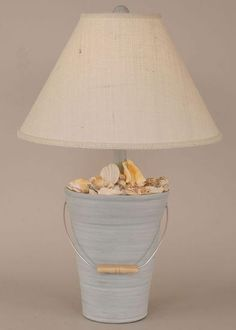 New blues!  Beach cottage light blue shell bucket beach lamp - perfect for a coastal cottage room... pinned with Pinvolve