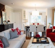 A pop of red done beautifully in this open concept home. I love that there is a nice flow in the decor and colors chosen for each part of this house. When you're decorating an open layout, match your decor and chosen colors to create a flow and a cohesive look in the home. Designed by Lux Decor